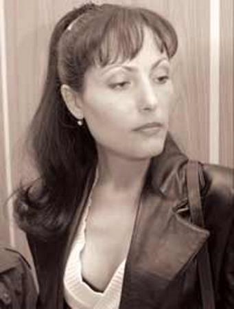 Елена Павлюченко, жена Мавроди, тоже участвовала в его биснесе. На суде, 2003 г.